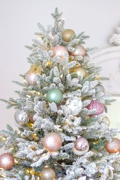 Pastel Christmas Tree and Holiday Bedroom Decor Ideas I added a bedroom Christmas tree and decorated it with blushes, blues, and greens. Pink Christmas Lights, Flocked Christmas Trees, Mini Christmas Tree, Christmas Tree Themes, Christmas Colors, Xmas Tree, All Things Christmas, Christmas Holidays, Christmas Wreaths