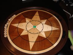 Crokinole.  Looks fun, but the boards are expensive!  Maybe build one some day?