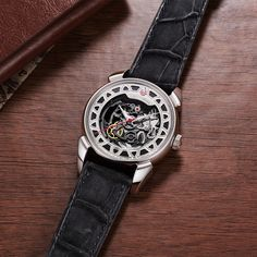The Historiador Squelette brings the timeless aesthetic appeal of skeleton watches to the Historiador collection. This model partially displays various movement parts to satisfy the wearer's curiosity about the automatic mechanisms tirelessly working beneath the dial. Skeleton Watches, Curiosity, Elegant, Model, Accessories, Collection, Historian, Skeleton, Classy