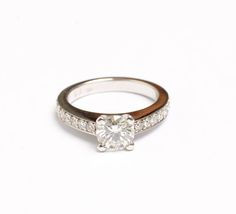 This ring is the perfect engagement ring to sit alongside a matching diamond bead-set wedding ring. In 18ct white gold with an excellent cut GIA certified 1.01ct round brilliant cut HSI centre stone and 12 shoulder stones totaling 0.30ct GSI this ring is perfection.