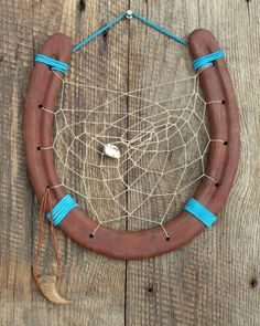 Hey, I found this really awesome Etsy listing at https://www.etsy.com/listing/203887130/carved-horseshoe-dream-catcher-12-with