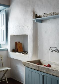 <strong>WATER WORKS</strong> | The kitchen of Forno Annex, featuring the original oven (now a stove) and marble sink.