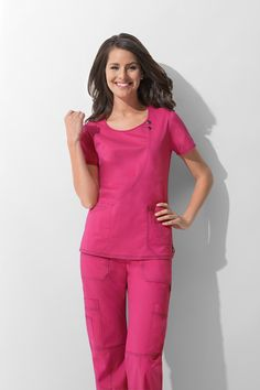 Dickies Gen Flex Youtility Round Neck Top: - Original Junior Fit utility top - Decorative snaps on an asymetrical curved style line - Hidden in-seam pocket over patch pocket - Patch pocket at left front with a sectional exterior pocket and bungee lo Stylish Scrubs, Cute Scrubs, Medical Scrubs, Nursing Scrubs, Medical Uniforms, Healthcare Uniforms, Scrubs Uniform, Poncho, Scrub Tops