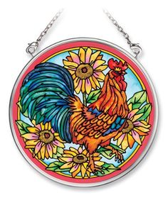 Amia 6442 Hand Painted Glass Suncatcher with Rooster Design, 3-1/2-Inch Circle by Amia. $10.00. Comes boxed, makes for a great gift. Handpainted glass. Includes chain. Amia glass is a top selling line of handpainted glass decor. Known for tying in rich colors and excellent designs, Amia has a full line of handpainted glass pieces to satisfy your decor needs. Items in the line range from suncatchers, window decor panels, vases, votives and much more.