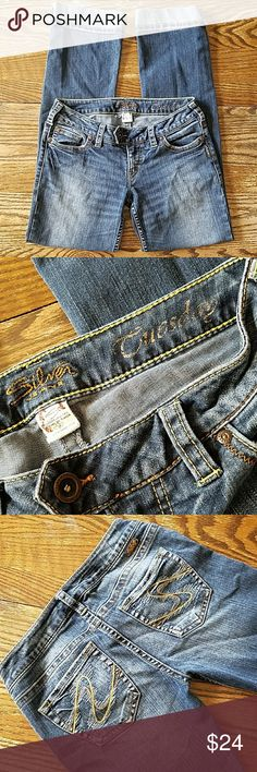 """Silver Tuesday Dark washed lowrise cuffed bootcut jeans with slight stretch.  Waist 27"""" Outseam 38"""" Front Rise 7"""". Silver Jeans Jeans Boot Cut"""
