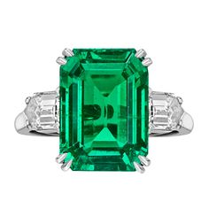 Colombian emerald ring with fancy-cut diamond shoulders, the emerald-cut emerald weighing 8.20 carats and two bullet-cut diamonds weighing 1.10 total carats, mounted in platinum, signed Van Cleef & Arpels.