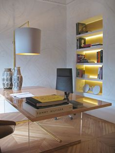 stripe lighting in bookcase adds mood and functional light in the office space