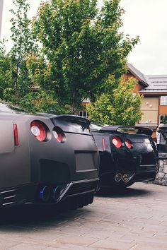 Godzilass. Matte and metallic black Nissan GT-R's.