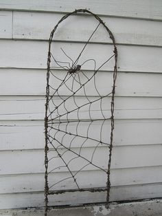 Spinning Spider In A Web Barbed Wire Garden Trellis by The Dusty Raven Gallery, via Flickr