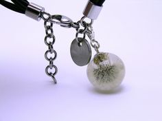 Bracelet charm made of natural whole dandelion (Hieracium pilosella L.), clear UV resistant resin and sterling silver. Bracelet is not for sale.