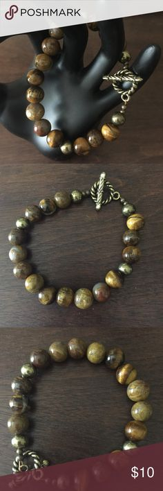 Winter Clearance!  Insight, Luck and Protection... this 7-1/2 inch bracelet is made simply of 10mm Tiger Eye semi precious gemstone beads with 8mm brass decorative beads and clasp.  This item is part of my artisan designed and created GEMZwithZEN jewelry line. GEMZwithZEN Jewelry Bracelets