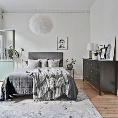 A beautiful bedroom with a patio door. Vita Eos lamp available online | @introinred