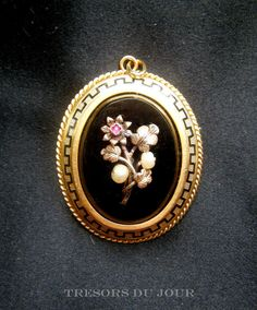 Antique VICTORIAN ONYX PENDANT and pin in 18kt with fine natural pearls and ruby and border of enamel Greek Key detail; an example of Victorian sentimental or memorial jewelry