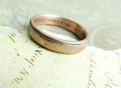 Rustic men's wedding band in rose gold with custom engraving on the inside for a personal touch