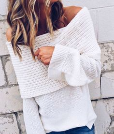 Off the shoulder white sweater.