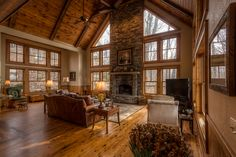 This beautiful, rustic 4,208 sq ft mountain home is situated on 1.11 acres in a private setting at the end of a cul-de-sac and boasts long range layered views of Grandfather Mountain, Hanging Rock, and Beech Mountain - VPC Builders