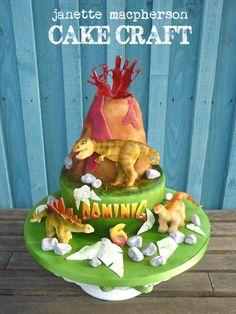 Volcano and dinosaurs birthday cake