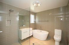 53 Ideas for bath room tiles australia garden photos Shower Shelves, Room Shelves, Pink Vanity, Building Contractors, Half Walls, Room Tiles, Best Bath, Grey Cabinets, Garden Photos