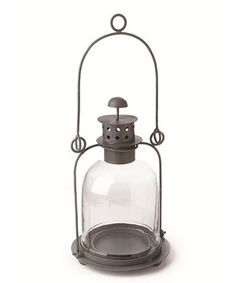 Hang this lantern on the porch or sit it on a shelf to provide indoor or outdoor décor with a rustic touch. The glass and metal construction is great for elegantly displaying candlelight.