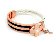 "A must have for your Rose Gold Collection...Sparkling clear crystals cover the pretty 5/8"" cross charm that dangles from this unique designer-style rose gold-tone, black enamel and braided white cord 7 1/4"" long cross bracelet."