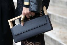 This structural wooden and leather clutch bag oozes with Bauhaus aesthetics #PFW WGSN street shot, Paris Fashion Week, spring/summer 2014