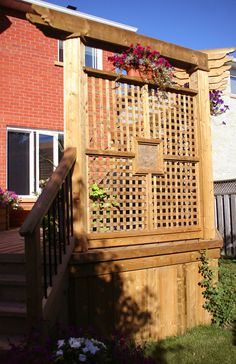 This link has a whole gallery of great ideas to adding wood work to any part of the home.  Lot's of ideas for the backyard.  The privacy screen is beautiful and there are many other privacy increasing ideas!