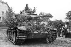 Panther tank with bush camouflage in Northern France, 1944 via Bundesarchiv