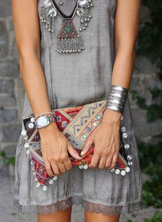 Women's fashion | Grey dress, statement necklace, silver accessories, clutch
