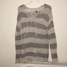 🆕* Beautiful woven long sleeve sweater Long sleeve this is a beautiful sweater a must see to appreciate its woven. With a ribbon v neck style front. Two tone gray. PRICE FIRM* Sonoma Sweaters