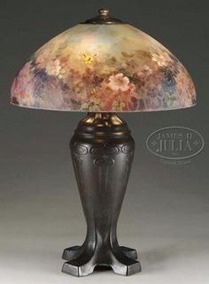 lighting, Connecticut, Handel #6688 table lamp.  Very nice Handel 6688 shade is decorated with reverse painted floral pattern in lovely pastel colors of pink, violet, white and yellow. SHade is ferther decorated with three yellow butterflies hovering about the flowers. Exterior of the shade is finished with chipped ice design. Shade rests on an Art Nouveau style bass with three socket cluster and  rich brown patina. Circa 1901-1935