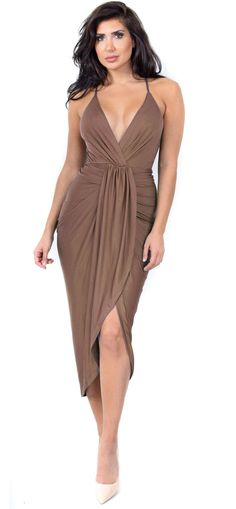 "- 90% Polyester, 10% Spandex - High low drape front - Deep V neckline - Lined - Cross back - Adjustable straps - Model is 5'8.5"" and is wearing a size Medium Measurements: - Bust: 36C Waist: 28"" Hip:"
