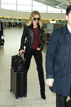 Here she is! Rosie Huntington-Whiteley reiterated her style credentials when she arrived at London's Heathrow airport on Friday, where she looked effortlessly chic in an off-duty style