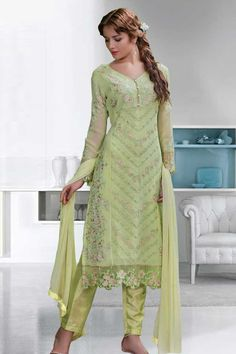 Light green Georgette Trouser Suit With Dupatta Light green, Georgette, semi stictch trouser suit. Allover embroidered with embroidered, resham, zari and stone work.  V neck, Below knee length, full sleeves kameez.   Light green, santoon trouser.   Light green, chiffon dupatta with lace border with work.  http://www.andaazfashion.co.uk/light-green-georgette-trouser-suit-with-dupatta-dmv13632.html