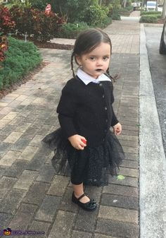 My 2 year old daughter Arabella About a month ago a family member told us that she looks just like Wednesday Adams from the Adams Family movie I just purchased very ominous looking clothing and decided to make a sparkly tutu to dress it up a. Photo 2 of Wednesday Addams Halloween Costume, Baby Girl Halloween Costumes, Halloween Costume Contest, Halloween Kids, Adams Family Costume Wednesday, Halloween Costumes Adams Family, Baby Halloween Costumes For Girls, Diy Toddler Halloween Costumes, Family Costumes For 3