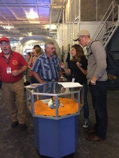 Lunar Rock on display with NASA Ames Coordinator Cara Dodge.