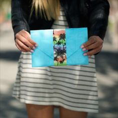 Learn how to create a stylish, fun magnetic clutch made with duct tape. This fashionable DIY purse can go with any outfit when you personalize it with Duck® brand's variety of prints and colors. http://www.duckbrand.com/craft-decor/activities/magnetic-clutch?utm_campaign=dt-crafts&utm_medium=social&utm_source=pinterest.com&utm_content=duct-tape-crafts-purses