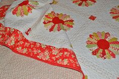 Ok folks, crank up the Christmas music and pour yourself a glass of eggnog,  because we have a Christmas in July quilt finish!  It all started with a Dresden plate quilt tutorial by Bunny Hill. Dresdens  have always been one of my favorite designs, but I thought that they were  too difficult for me. Anne Sutton's pattern sure looked easy. Just use  this ruler to cut wedge shapes, sew them inside out and then flip them to  the right side, stitch them all together and applique them down to a…