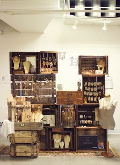 Exceptional use of old wooden crates, palettes, barrels and drawers for display and storage!