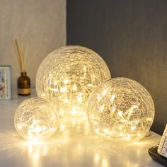 Set Of 3 LED Illuminated Clear Crackled Glass Ball Lights By Lumineo £39.99 | Lights4fun.co.uk. #Lights4Weddings.