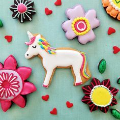 We're feeling a little psychedelic at Biscuiteers HQ today, so we've made a rainbow unicorn biscuit/cookie. You can pick up the flower biscuits online!