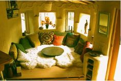 Charming Cob Living Room. Absolutely ideal scenario? Cob round building, with a Smiling Woods Yurt roof. HEAVEN.