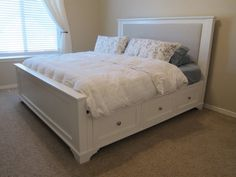 White Wooden Kingsize Bed With Storage Drawer And Headnboard Using Grey  Upholstered Panel Using White And