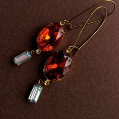 $12.00.  Smoky Topaz and Aqua earrings on French wires.  Love these and the vendor.  :)