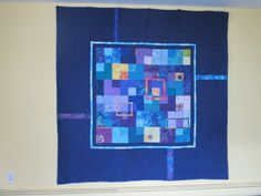 2010. Anniversary quilt made for my husband.  It was made with leftover squares from another quilt, accented with warm batik fabrics.