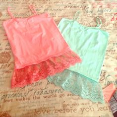 2 CAMI  SPAGHETTI TANKS GOOD CONDITION MINT AND CORAL COLOR AND LITTLE WEAR BUT STILL WORTH BUYING WEAR UNDER  ANYTHING WITH LITTLE LACE HANGING OUT THE BOTTOM OF YOUR SHIRT SO DARLING NOT VS PINK BUT POSTED FOR VIEWS AND SIZE SAYS L/XL PINK Victoria's Secret Tops Tank Tops