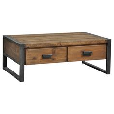 Featuring a rustic Mission-style silhouette, this distressed coffee table is highlighted by contrasting banding. 4 drawers provide stylish storage for essent...