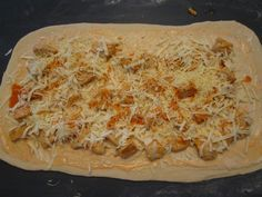 Buffalo Chicken Garbage Bread: 2 boneless chicken breasts, 1 tsp. olive oil, 1 pizza dough (can use store bought--let it sit out for about 20 min.), 8 oz. shredded mozzarella cheese (part skim), 3 oz. shredded cheddar cheese, 1/2 c. Franks Wing Sauce, 1/3 c. ranch or blue cheese dressing