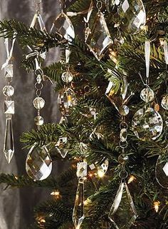 Your Christmas tree will sparkle and shine when you adorn it with the Set of 24 Crystal Droplets with Silver Hangers that also serve as beautiful decorative accents atop your gift packages.