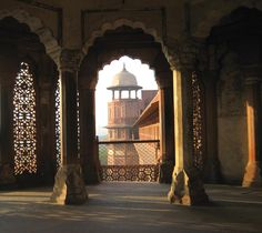 Agra Fort, India ~ View of a guard tower through a scalloped window