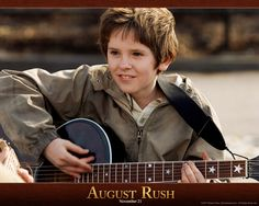 August Rush movie stills featuring Jonathan Rhys Meyers, Keri Russell, Terrence Howard, Robin Williams and Freddie Highmore. August Rush, Freddie Highmore, Norman Bates, Rush Movie, Movie Tv, Favorite Movie Quotes, Movie Lines, Entertainment, Tv Show Quotes